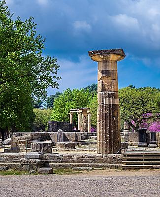 Multiple ruins of ancient Greek pillars in Olympia