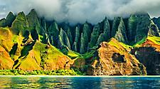 An exotic green mountainside with the peaks hidden by clouds on the coastline of Kauai, Hawaii