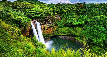 Beautiful luscious landscape surrounding the waterfalls called Wailua Falls in Kauai, Hawaii