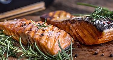 Grilled Salmon topped with rosemary, which is one of the most popular dishes in Ketchikan, Alaska