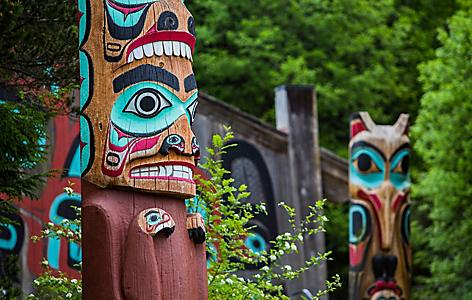 Detail of totem pole at Saxman Village tribal house near Ketchikan, Alaska