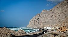 A coastal road and village in Oman