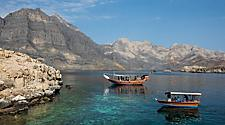 Boats anchored in a fjord in Oman