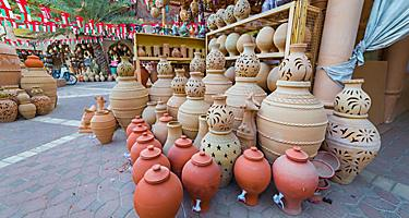 Clay jugs for sale at a market in Oman
