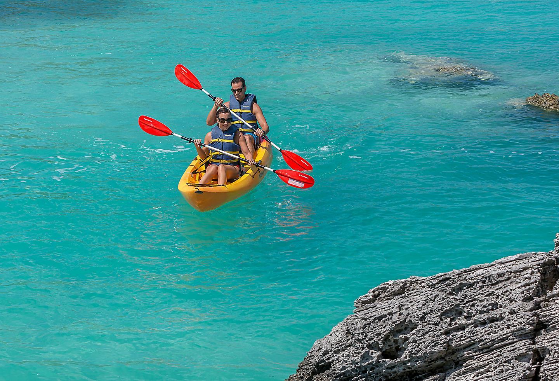 Bermuda Kings Wharf Couple Kayaking Blue Waters