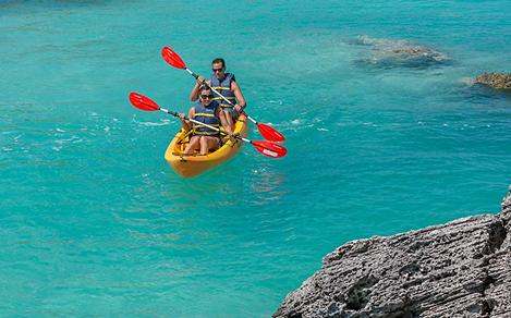 Bermuda Kings Wharf Couple Kayaking Blue Waters