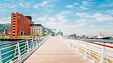 Blue wing moji bridge and sea in Mojiko retro town, Kitakyushu, Japan