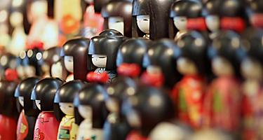 Traditional wooden japanese dolls sold in souvenir shops in Japan
