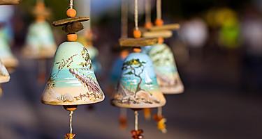 An assortment of traditional souvenir bells