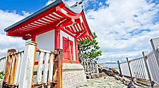 A small red shrine on the point of Katsurahama beach in Kochi, Japan
