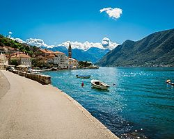 Coastal road with docks docked in the bay in Kotor, Montenegro