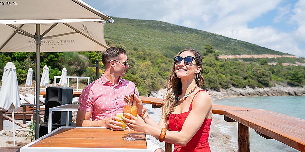 Couple Enjoying Cocktails by the Montenegro Coast