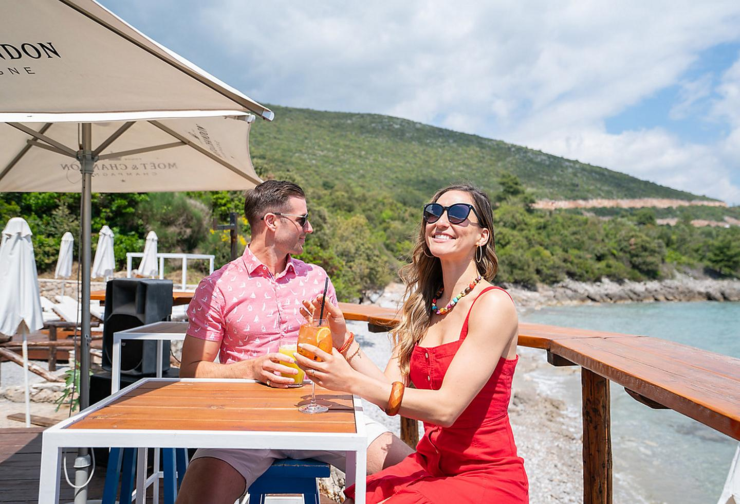 Couple Enjoying Cocktails by the Montenegro Coast