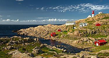 Coastal buildings and a lighthouse in Kristiansand, Norway