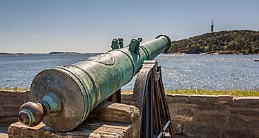 A vintage cannon overlooking the ocean in Kristiansand, Norway