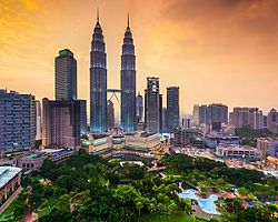 The skyline of Kuala Lumpur in Malaysia during a golden sunset