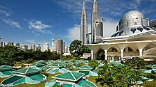 View of the cityscape with the modern archiecture Twin Towers and Mosque in Kuala Lumpur, Malaysia