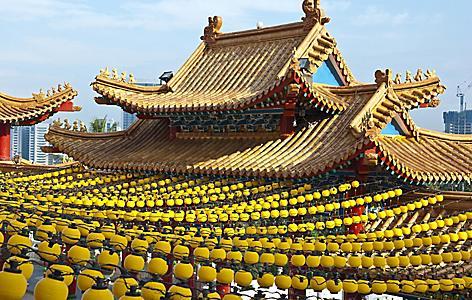 Yellow lanterns hanging on the roof of the temple in Kuala Lumpur, Malaysia