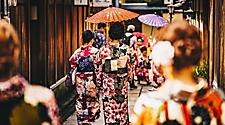 Women in Japenese traditional clothing walking the streets of Kyoto, Japan