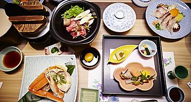 Kaiseki and traditional Japenese cuisine layed out on a table