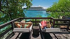 Young couple relaxing in a private bungalow at Nellie's Beach, Labadee, Haiti