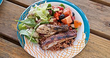 A plate of rice, salad, chicken and fish from Dragons Cafe in Labadee, Haiti