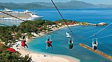 4 friends zip lining down Dragon's Breath Flight Line overlooking Labadee, Haiti