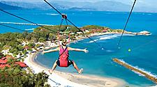 Girl zip lining down Dragon's Breath Flight Line, Labadee, Haiti