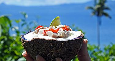 A coconut filled with Kokoda, a raw fish salad