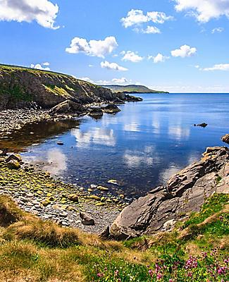 Coast terrain and a secluded bay in Scotland