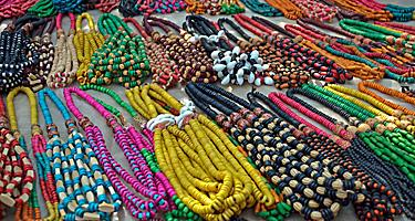 An assortment of colorful necklaces for sale