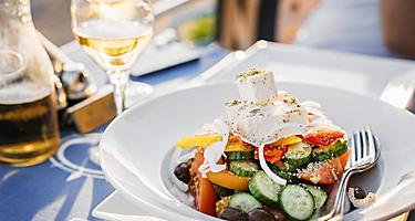 Greek salad with fresh cucumbers, tomatoes, basil and olives, in Limassol, Cyprus