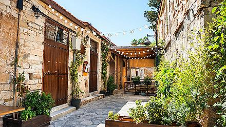 Beautiful old street decorated with plants and lights in Limassol, Cyprus