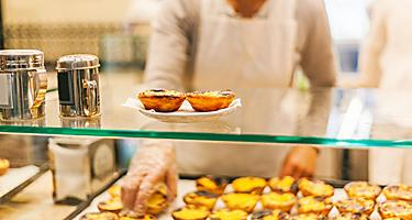 A tray full of Pasteis de Nata pastries in Lisbon, Portugal