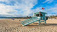 A lifeguard hut on a beach in Santa Monica