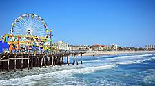 View of the ferris wheel and roller coaster on the Santa Monica pier in California