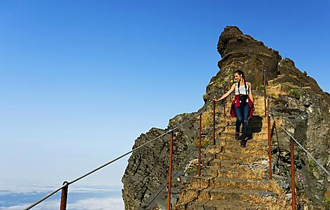 A woman climbing the staircase at Pico de Areeiro in Madeira (Funchal), Portugal
