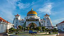 Front view of the Malacca Straits mosque with a garden, in Malacca, Malaysia