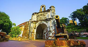 Remains of A Famosa, a former Portuguese fortress, with a cannon, in Malacca, Malaysia