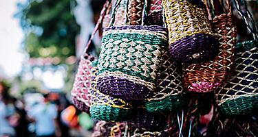 A bunch of colorful handmade purse made out of Manila hemp sold on the streets in the Philippines