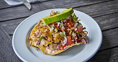Citrus-marinated raw fish scooped up with pieces of deep-fried tortilla, in Manzanillo, Mexico