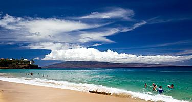 Kaanapali beach in Lahaina, Maui, Hawaii with views of volcanos
