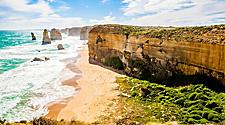 The Twelve Apostles, Great Ocean Road, a beach along the coast with a cliff and rocks in Melbourne, Australia