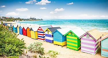 Colorful bathing houses on white sandy beach at Brighton beach in Melbourne