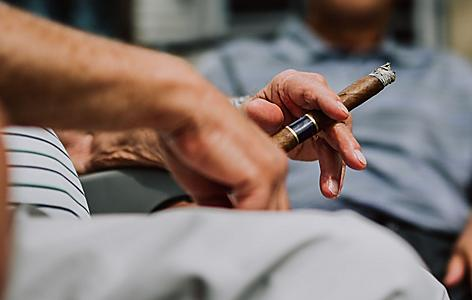 Close up of men smoking Cuban cigars in Miami, Florida