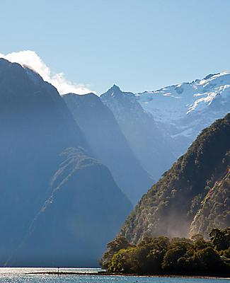 Mountain peaks on a cloudy day in Milford Sound, New Zealand