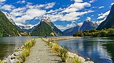 A pathway through a naturesque body of water with mountains around in New Zealand