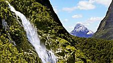 Waterfall cascading down the mountains in Milford Sound, New Zealand
