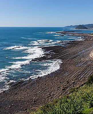 The Nichinan coastline viewpoint with dark volcanic sand in Miyazaki, Japan