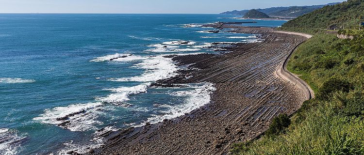 The Nichinan coastline viewpoint with dark volcanic sand in Miyazaki, Japan